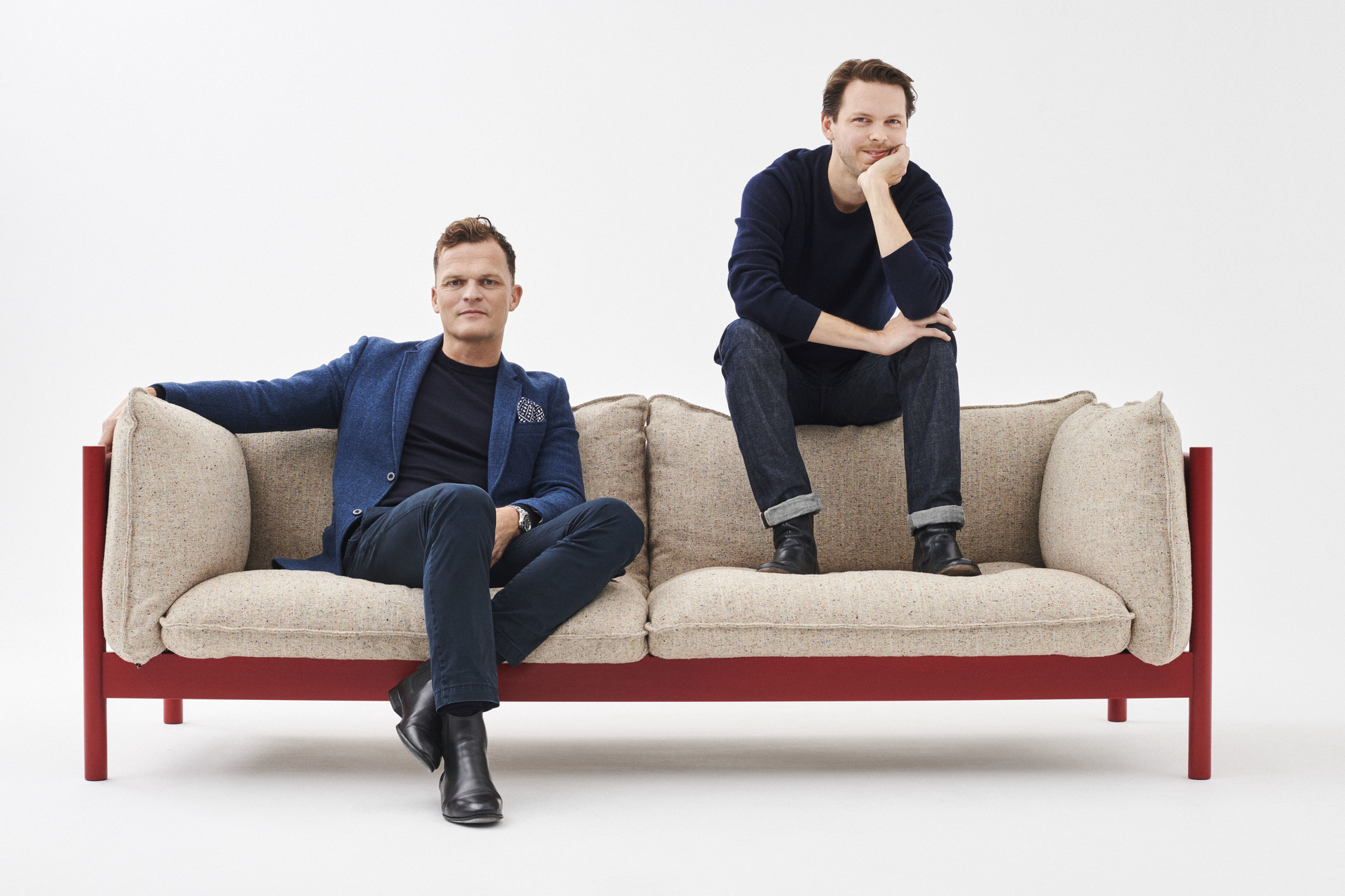 Barkley's brothers posing on the first sofa they built together