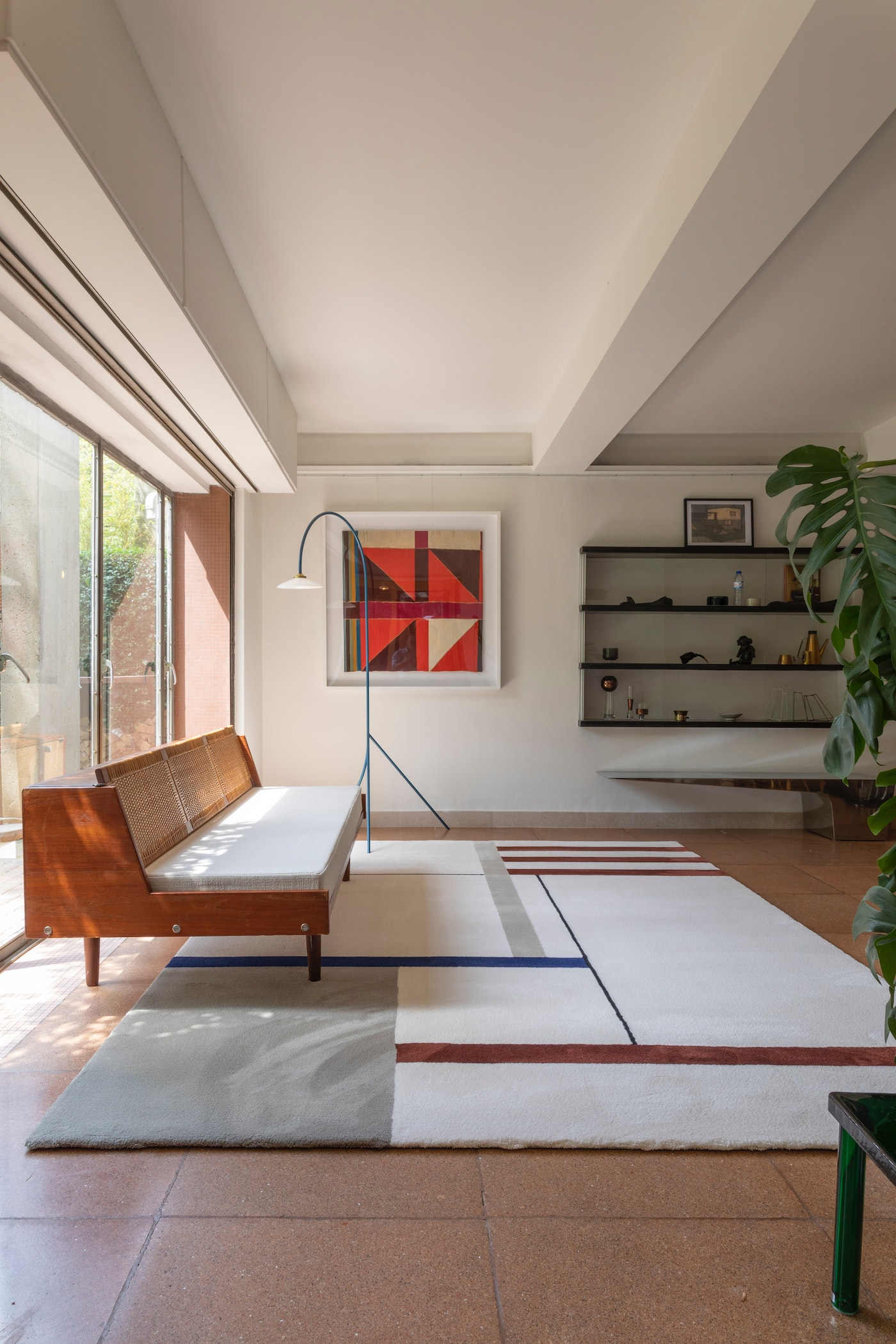 A living room with a graphic rug