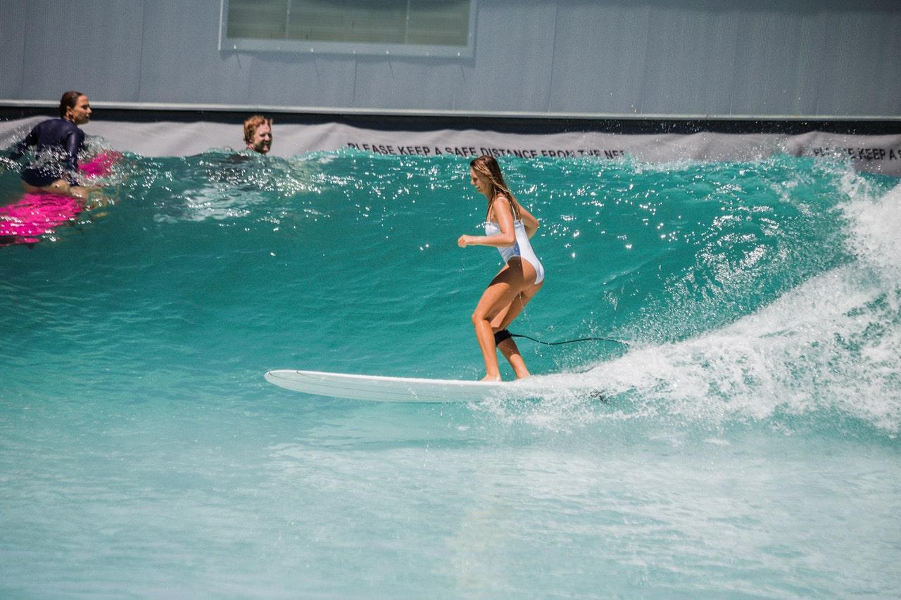 woman on longboard swiss wavepool