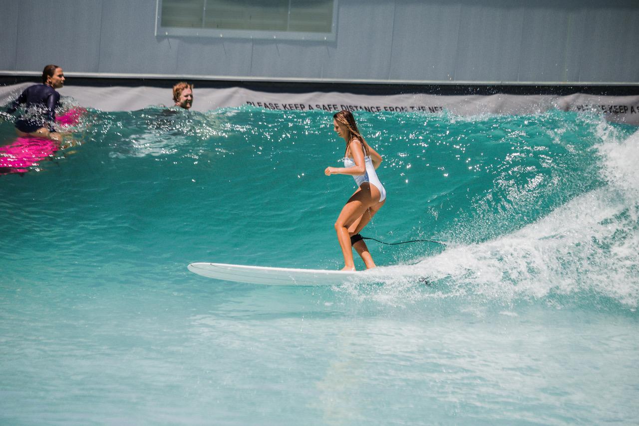 woman surfing at Alaïa Bay