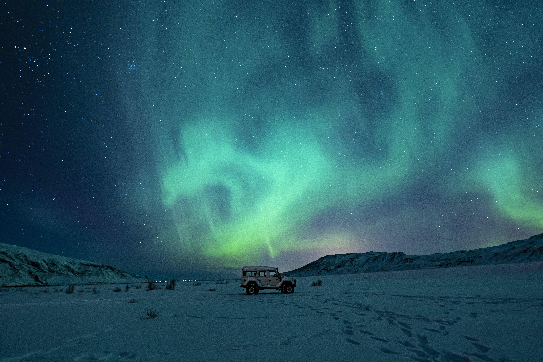 Green aurora borealis and snow.