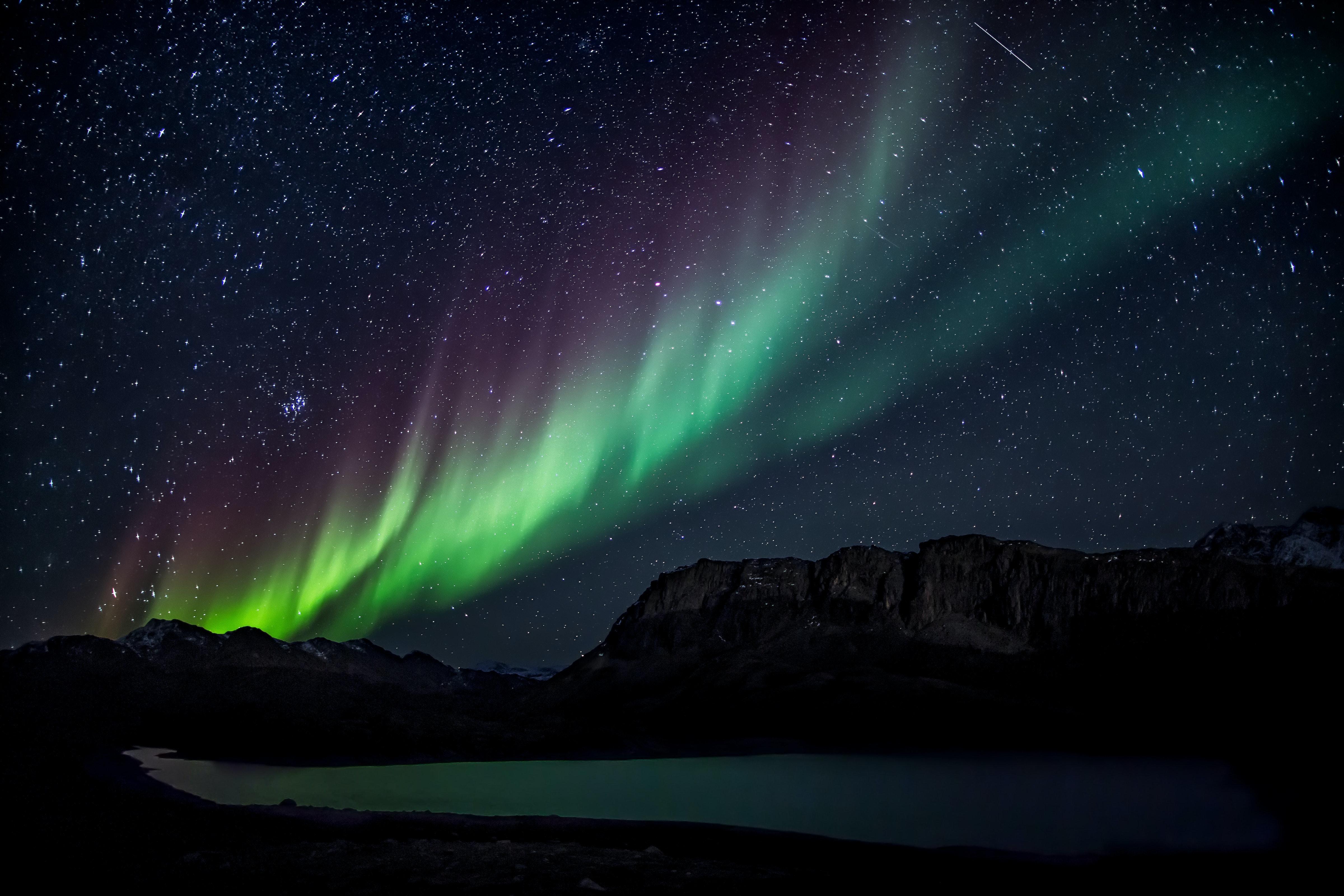 Green, blue and purple aurora borealis.